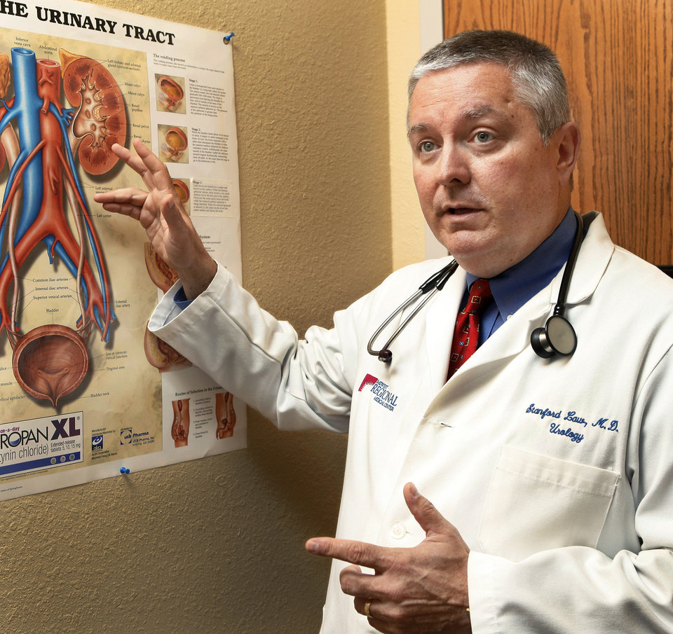 Photo - Dr. Stan Law, a urologist at Midwest Regional Medical Center, discusses a  vasectomy in an exam room. Photo by Jim Beckel, THE OKLAHOMAN