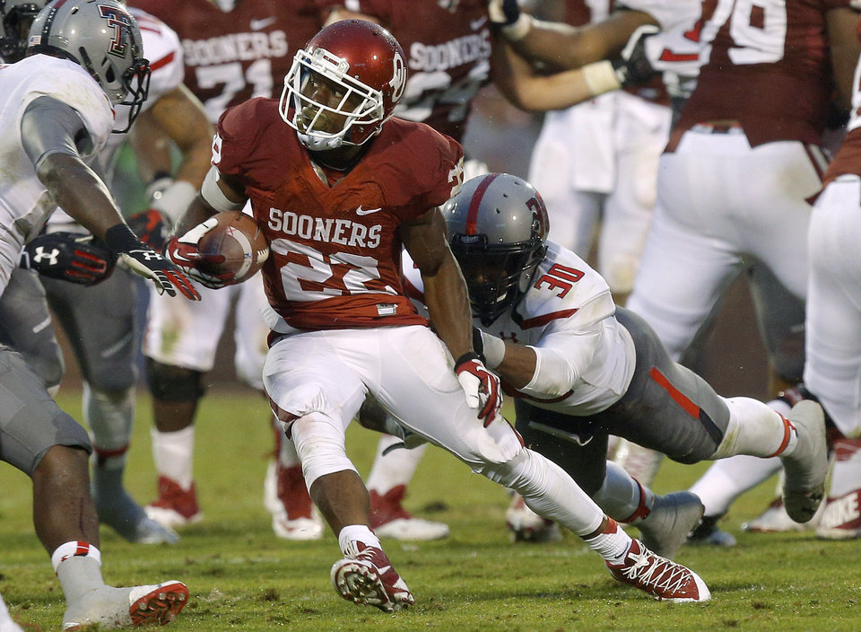 Photo -  Oklahoma's Roy Finch (22) runs past Texas Tech's Austin Stewart (30) during a college football game between the University of Oklahoma Sooners (OU) and the Texas Tech Red Raiders at Gaylord Family-Oklahoma Memorial Stadium in Norman, Okla., on Saturday, Oct. 26, 2013. Oklahoma won 38-30. Photo by Bryan Terry, The Oklahoman