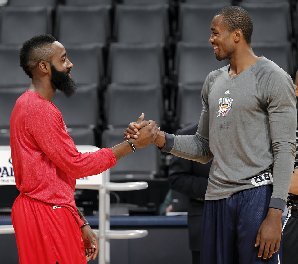 Houston\'s James Harden and Oklahoma City \'s Serge Ibaka shake hands in shoot-around during the NBA basketball game between the Houston Rockets and the Oklahoma City Thunder at the Chesapeake Energy Arena on Wednesday, Nov. 28, 2012, in Oklahoma City, Okla. Photo by Chris Landsberger, The Oklahoman