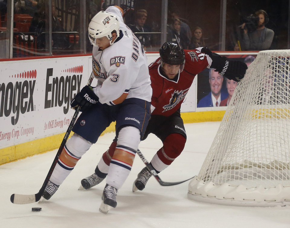 Brandon Davidson of the Oklahoma City Barons tries to get past Mark Olver of the Lake Erie Monsters during AHL hockey game at the Cox Convention Center in Oklahoma City, Tuesday, October 23, 2012. Photo by Bryan Terry, The Oklahoman