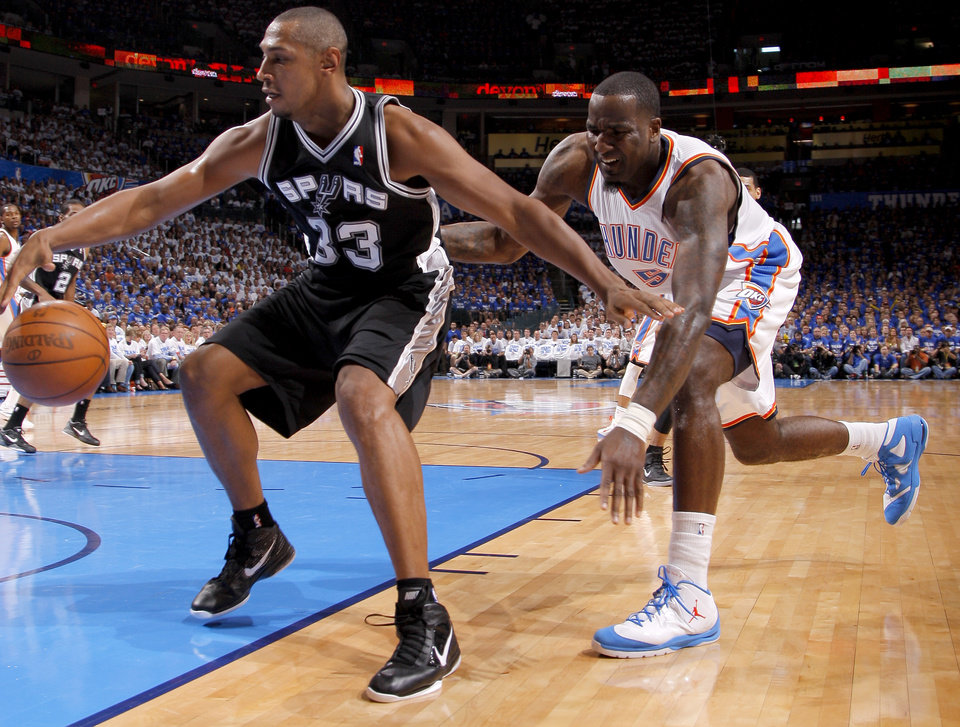 Photo - Oklahoma City's Kendrick Perkins (5) goes after San Antonio's Boris Diaw (33) during Game 4 of the Western Conference Finals between the Oklahoma City Thunder and the San Antonio Spurs in the NBA playoffs at the Chesapeake Energy Arena in Oklahoma City, Saturday, June 2, 2012. Oklahoma CIty won 109-103. Photo by Bryan Terry, The Oklahoman
