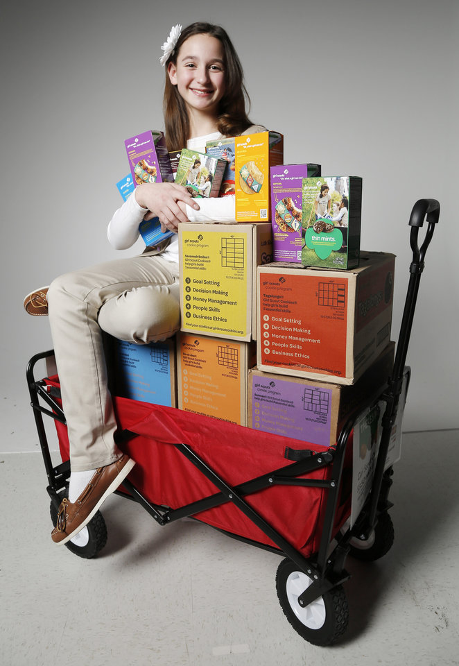 Katie Francis, 11, the state record-holder for Girl Scout cookie sales, is now going for the world record. Photo by Doug Hoke, The Oklahoman  <strong>DOUG HOKE -   </strong>