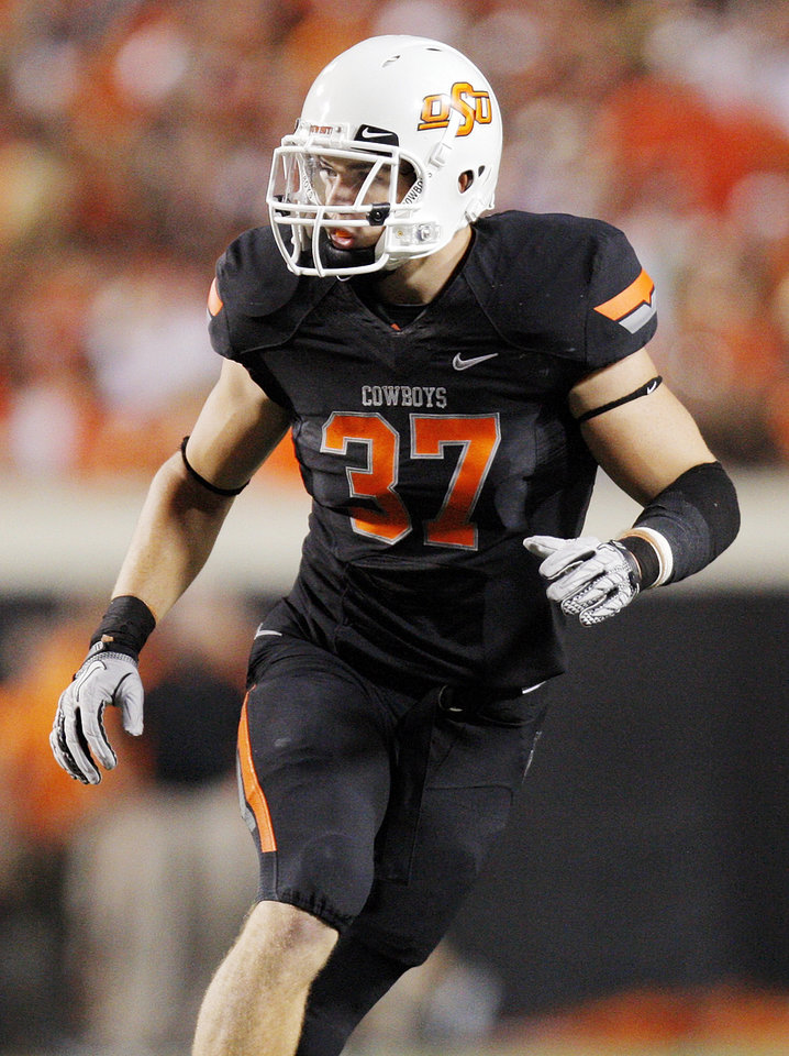 Oklahoma State's Alex Elkins (37) defends in the first half during a college football game between the Oklahoma State University Cowboys (OSU) and the University of Arizona Wildcats at Boone Pickens Stadium in Stillwater, Okla., Thursday, Sept. 8, 2011. Photo by Nate Billings, The Oklahoman  ORG XMIT: KOD