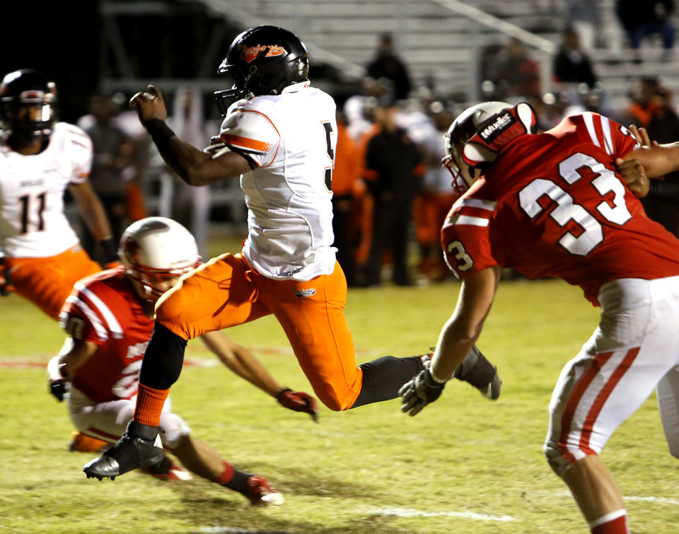 Douglass' Chavez Wyatt scores against  McLoud in high school football on Thursday, Oct. 18, 2012 in McLoud , Okla.  Photo by Steve Sisney, The Oklahoman