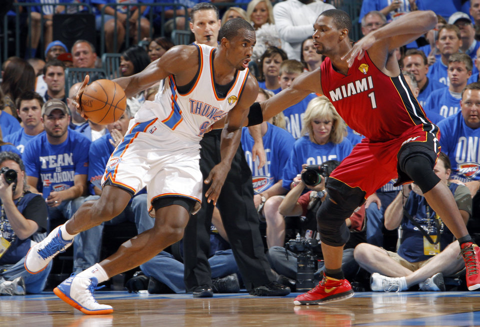Oklahoma City's Serge Ibaka (9) looks to drive past Miami's Chris Bosh (1) during Game 1 of the NBA Finals between the Oklahoma City Thunder and the Miami Heat at Chesapeake Energy Arena in Oklahoma City, Tuesday, June 12, 2012. Photo by Chris Landsberger, The Oklahoman