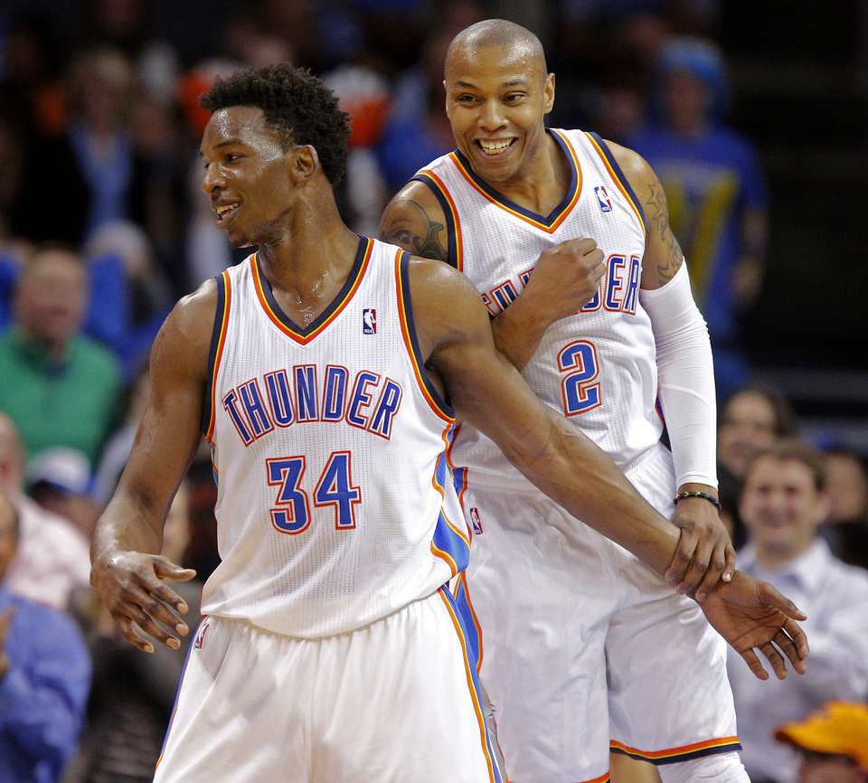 Oklahoma City's Hasheem Thabeet (34) and Caron Butler (2) celebrate after Thabeet made a basket during an NBA basketball game between the Oklahoma City Thunder and the Philadelphia 76ers at Chesapeake Energy Arena in Oklahoma City, Tuesday, March 4, 2014. Oklahoma City won 125-92.  Photo by Bryan Terry, The Oklahoman