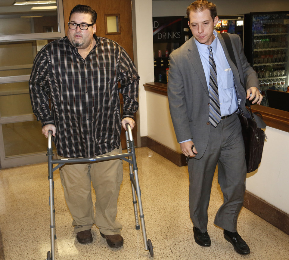 Photo - Bryan Abrams, left, Color Me Badd front man and his attorney Matt Swain exit Judge Jequita H. Napoli's courtroom in the Cleveland County Courthouse in Norman, Wednesday November 20, 2013. Photo By Steve Gooch, The Oklahoman