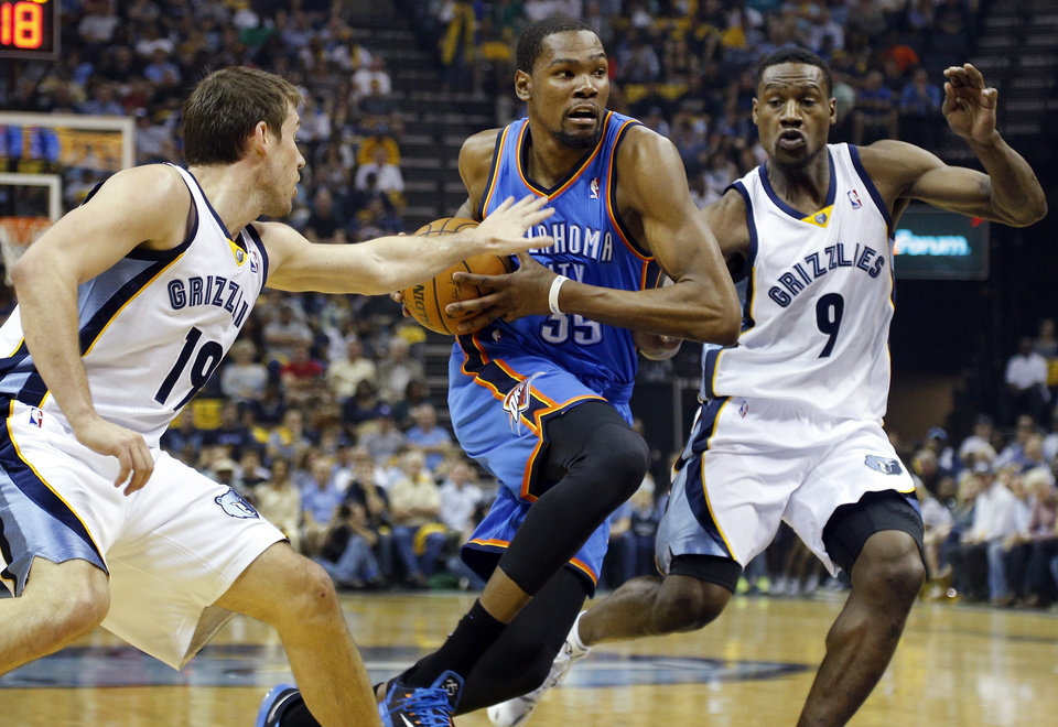 Oklahoma City's Kevin Durant (35) drives between Memphis' Beno Udrih (19) and Tony Allen (9) during Game 4 in the first round of the NBA playoffs between the Oklahoma City Thunder and the Memphis Grizzlies at FedExForum in Memphis, Tenn., Saturday, April 26, 2014. Photo by Bryan Terry, The Oklahoman