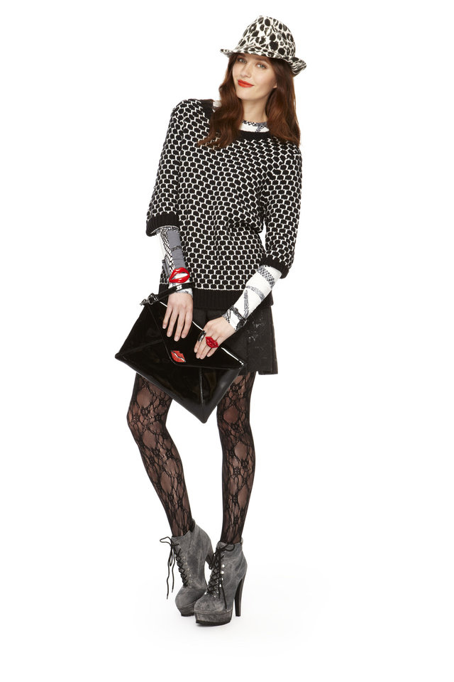 Sweater in black/white, long-sleeve tee in black/white, faux leather skirt, lace tights, fedora in black/white kiss print, envelope clutch in black patent, lips bracelet, all from Kirna Zabete for Target collection. Photo provided. <strong></strong>
