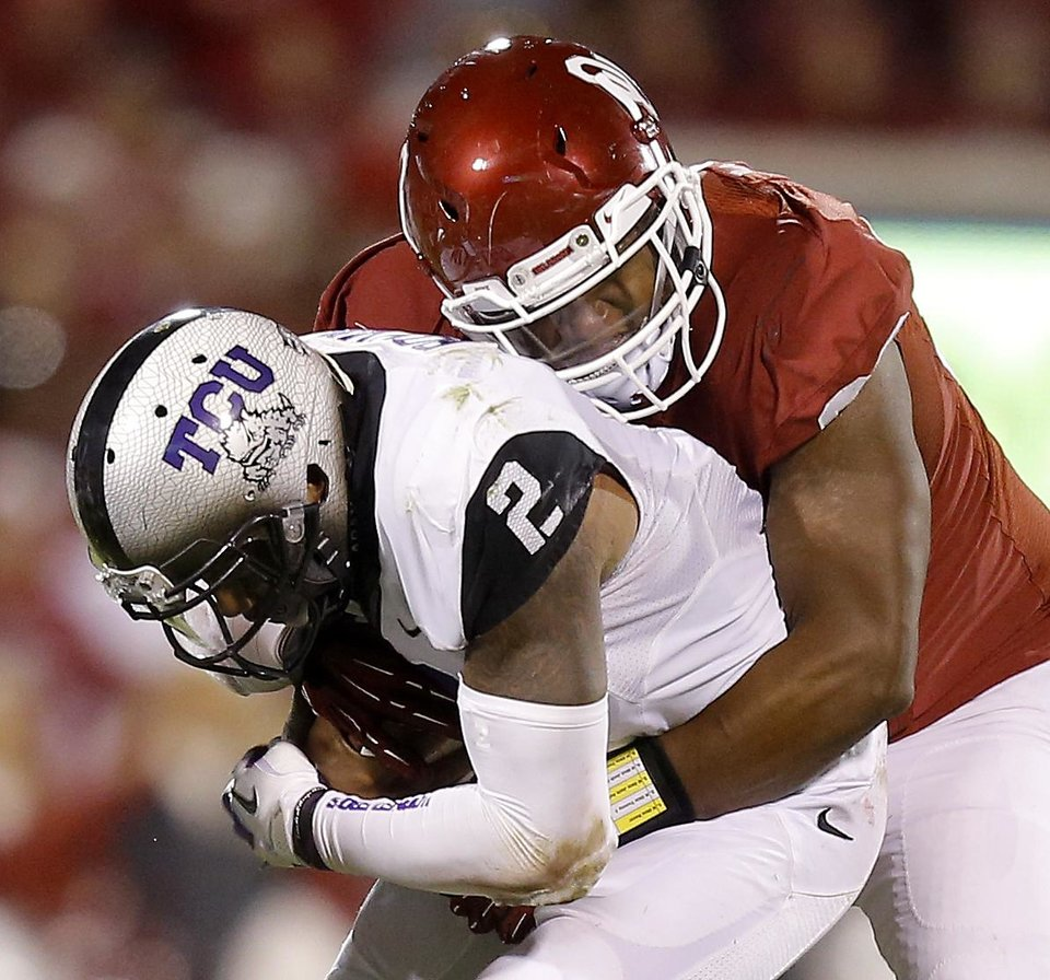 Photo - Oklahoma's Jordan Wade (93) brings down TCU's Trevone Boykin (2) during a college football game between the University of Oklahoma Sooners (OU) and the TCU Horned Frogs at Gaylord Family-Oklahoma Memorial Stadium in Norman, Okla., on Saturday, Oct. 5, 2013. Oklahoma won 20-17. Photo by Bryan Terry, The Oklahoman