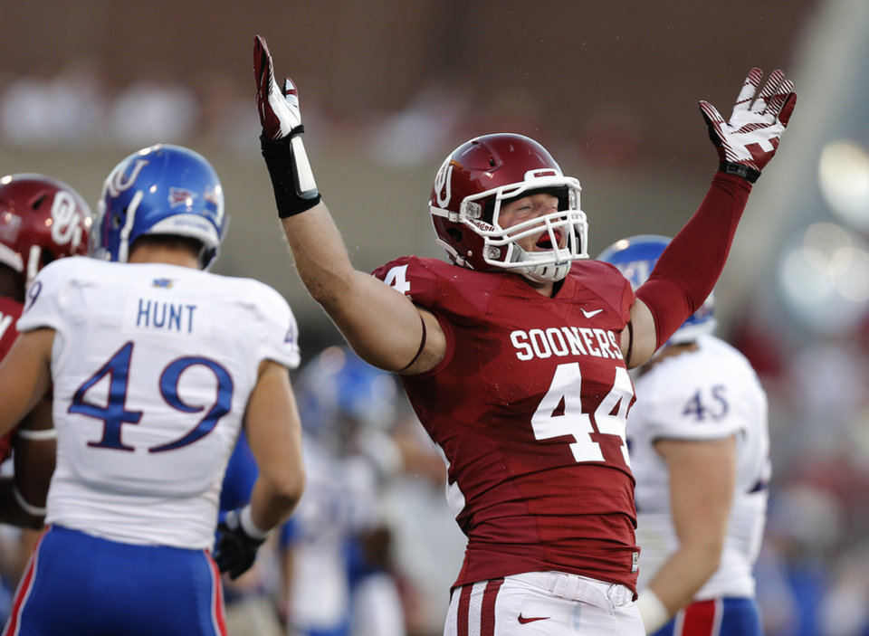 Photo - OU's Jaydan Bird (44) reacts after a stop on Kansas during the college football game between the University of Oklahoma Sooners (OU) and the University of Kansas Jayhawks (KU) at Gaylord Family-Oklahoma Memorial Stadium on Saturday, Oct. 20th, 2012, in Norman, Okla. Photo by Chris Landsberger, The Oklahoman