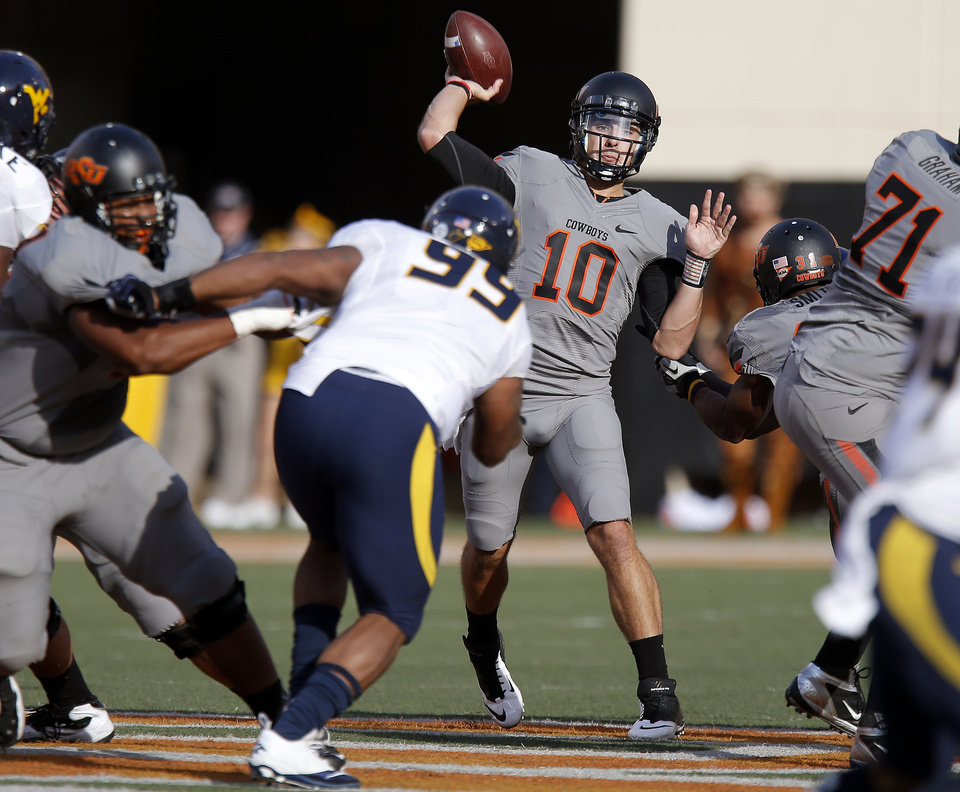 Oklahoma State\'s Clint Chelf (10) throws the ball during a college football game between Oklahoma State University (OSU) and West Virginia University at Boone Pickens Stadium in Stillwater, Okla., Saturday, Nov. 10, 2012. Photo by Bryan Terry, The Oklahoman