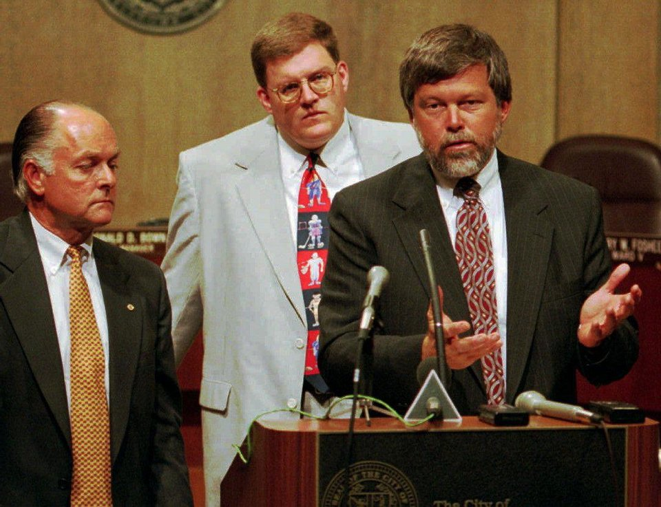 Photo - Former Mayor Ron Norick (left) and Clay Bennett (center) listen to Rick Horrow of Horrow Sports Ventures talk about the attempts of a private citizens' group to attract an NHL or NBA franchise at a 1995 press conference.   ROGER KLOCK