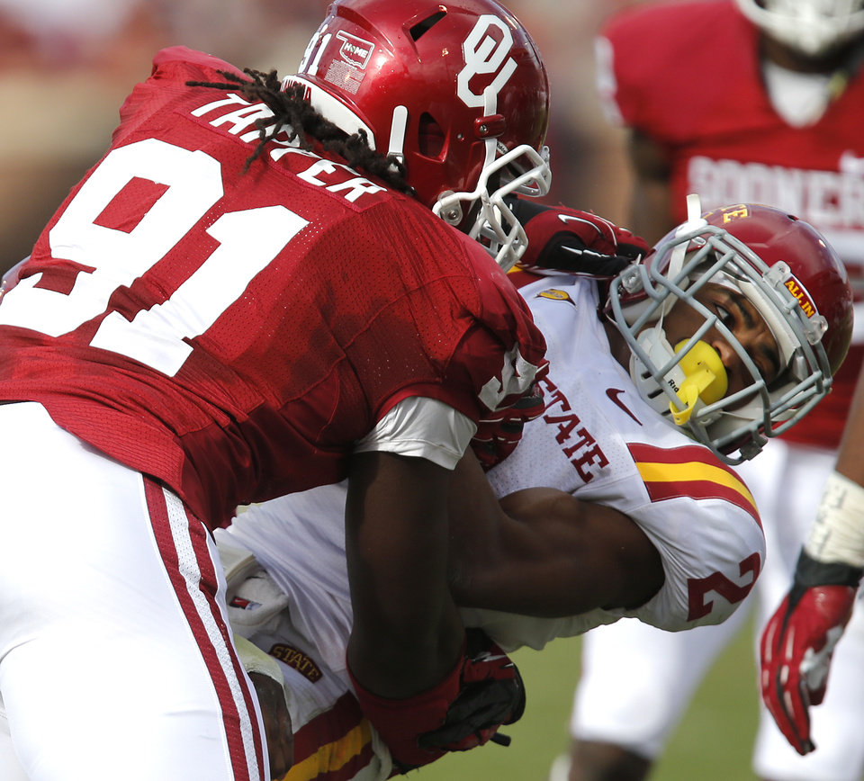 Oklahoma's Charles Tapper (91) stops Iowa State's Aaron Wimberly (2) during the college football game between the University of Oklahoma Sooners (OU) and the Iowa State University Cyclones (ISU) at Gaylord Family-Oklahoma Memorial Stadium in Norman, Okla. on Saturday, Nov. 16, 2013. Photo by Chris Landsberger, The Oklahoman