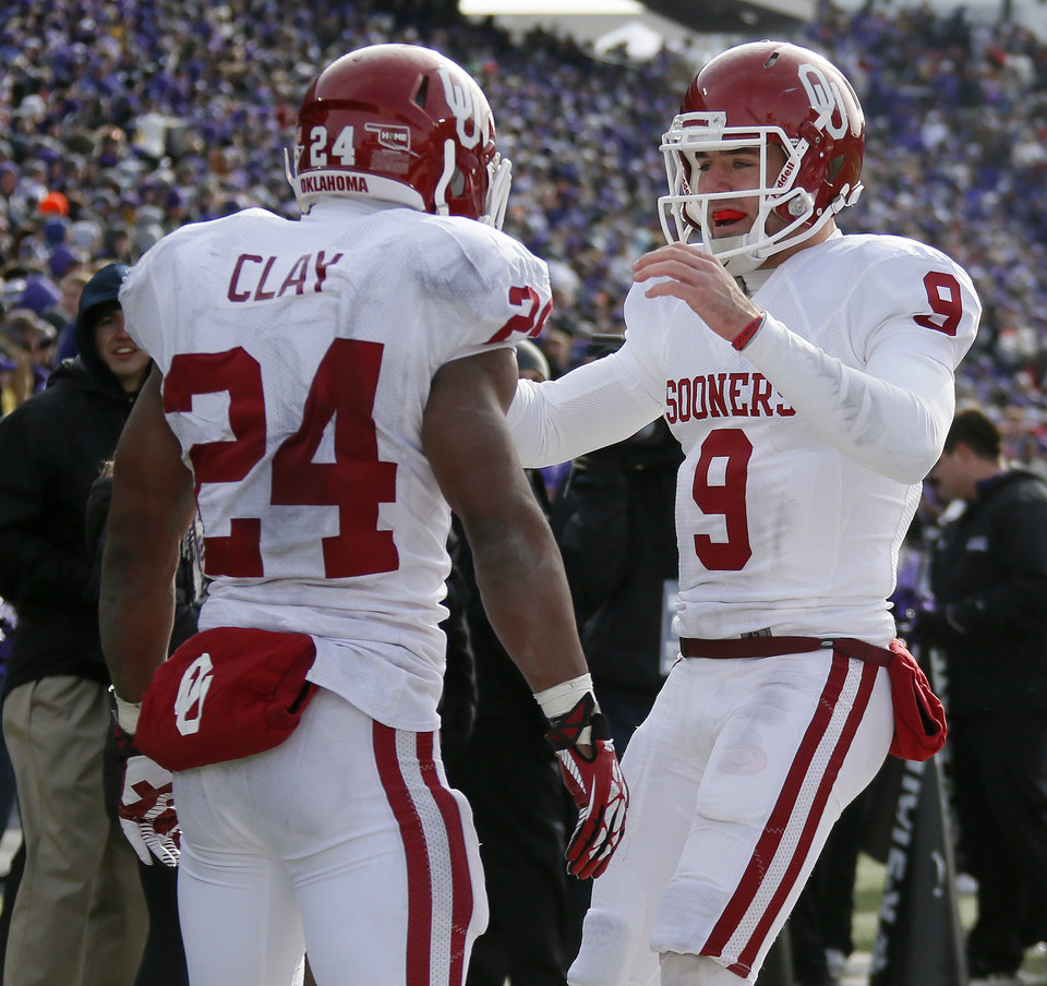 Oklahoma's Trevor Knight (9) celebrates with Brennan Clay (24) after a touchdown during an NCAA college football game between the Oklahoma Sooners and the Kansas State University Wildcats at Bill Snyder Family Stadium in Manhattan, Kan., Saturday, Nov. 23, 2013. Oklahoma won 41-31. Photo by Bryan Terry, The Oklahoman