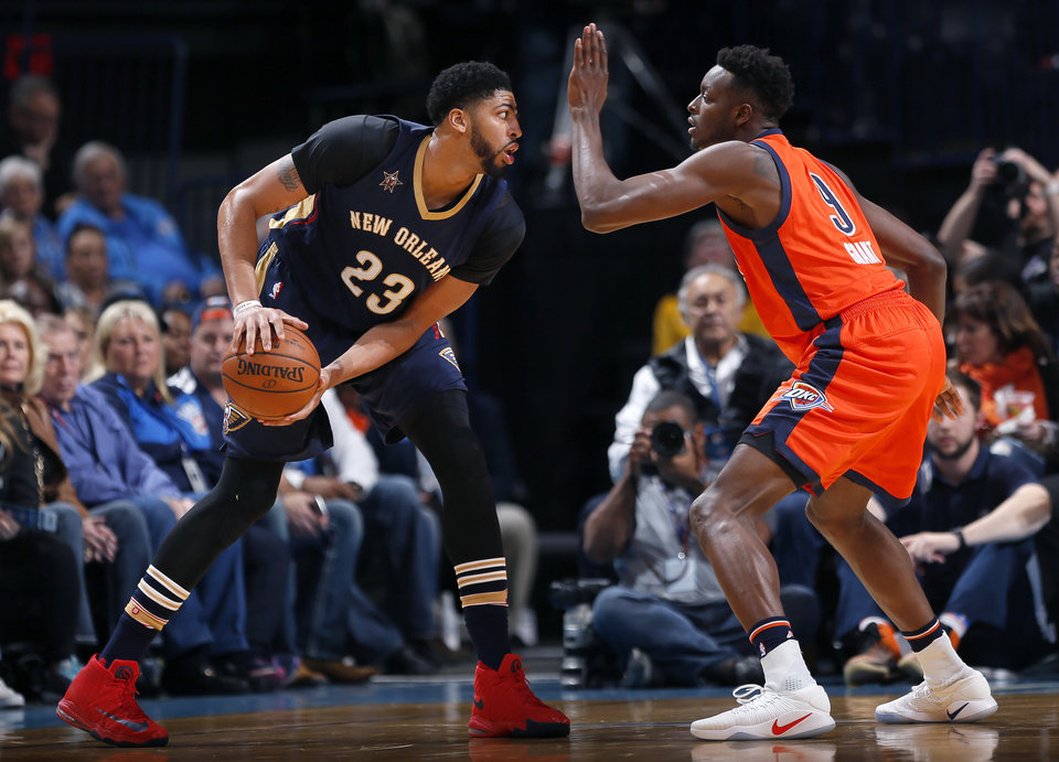 Photo - Oklahoma City's Jerami Grant (9) defends against New Orleans' Anthony Davis (23) during the NBA game between the Oklahoma City Thunder and the New Orleans Pelicans at the Chesapeake Energy Arena,  Sunday, Dec. 4, 2016. Photo by Sarah Phipps, The Oklahoman