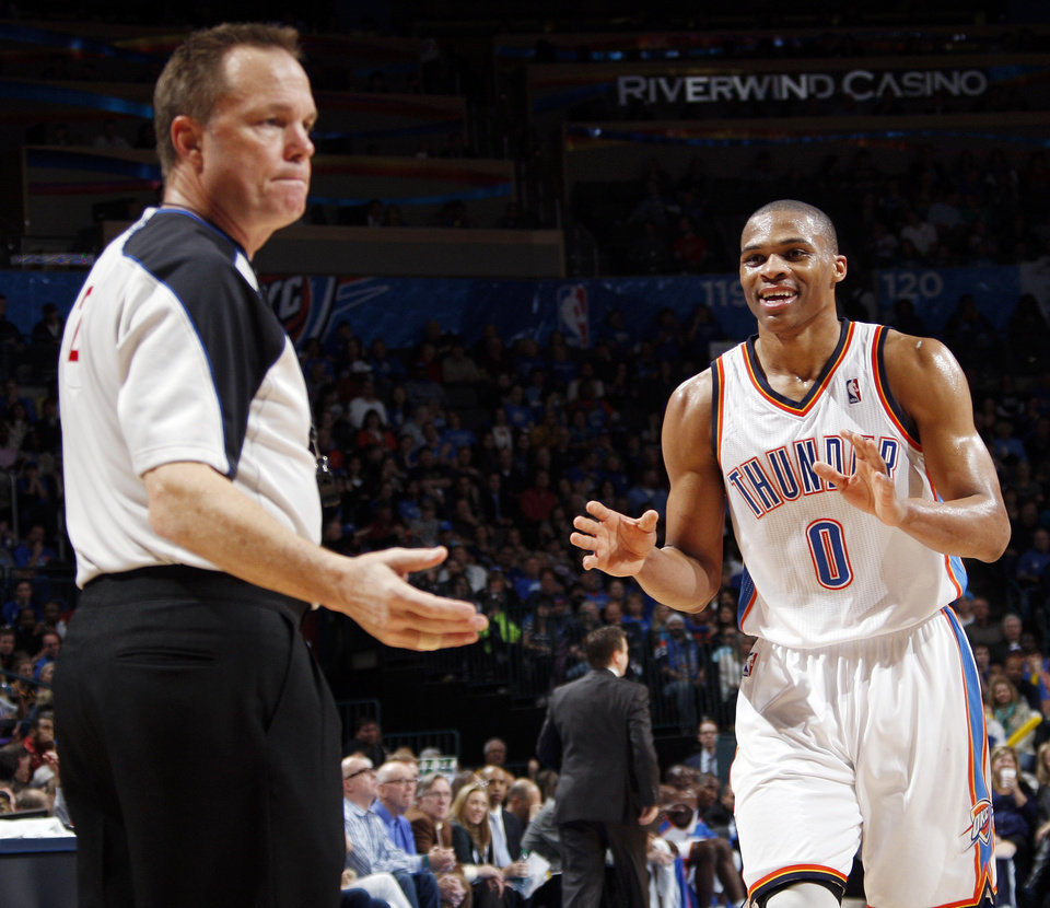Photo - Oklahoma City's Russell Westbrook (0) pleads his case to referee Bill Spooner after Westbrook was called for a foul during the NBA basketball game between the Oklahoma City Thunder and the Golden State Warriors at the Chesapeake Energy Arena in Oklahoma City, Friday, Feb. 17, 2012. The Thunder won, 110-87. Photo by Nate Billings, The Oklahoman