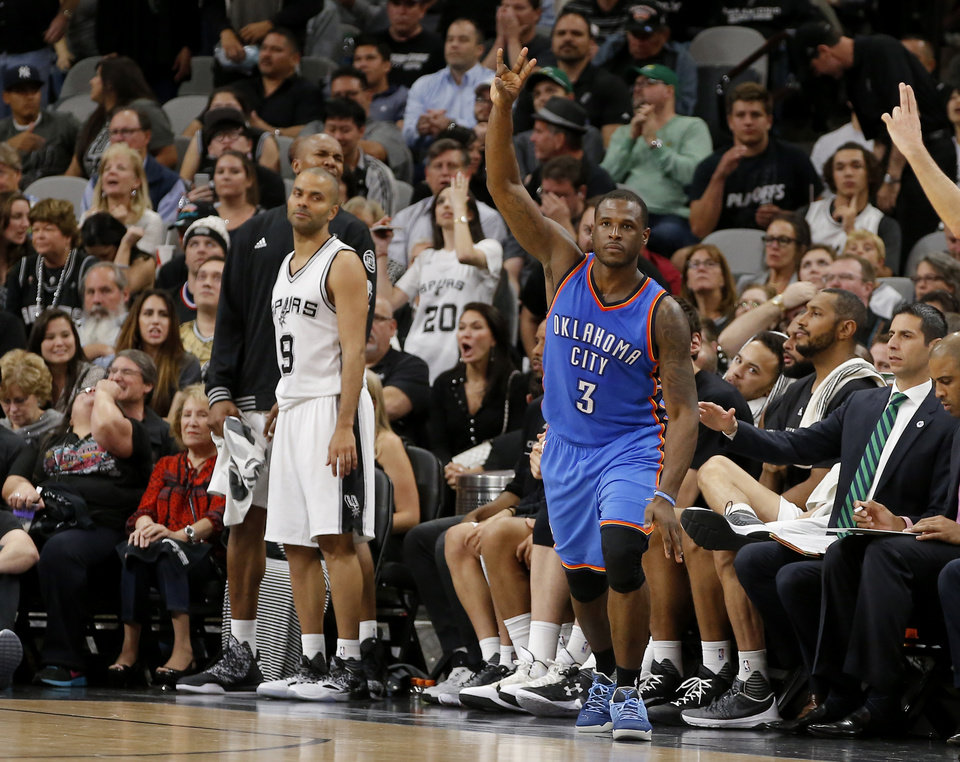 Photo - Oklahoma City's Dion Waiters (3) celebrates a 3-pointer beside San Antonio's Tony Parker (9) during Game 2 of the second-round series between the Oklahoma City Thunder and the San Antonio Spurs in the NBA playoffs at the AT&T Center in San Antonio, Monday, May 2, 2016. Oklahoma City won 98-97. Photo by Bryan Terry, The Oklahoman