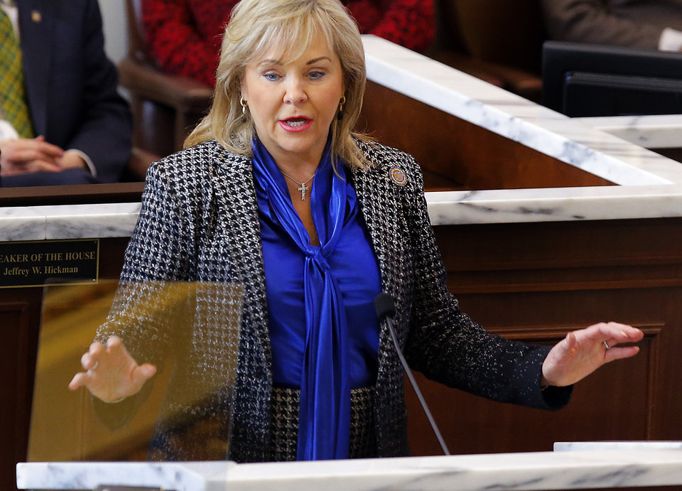 Photo -  Gov. Mary Fallin speaks Monday to lawmakers during the Oklahoma Legislature's 2016 State of the State address in the chamber of the House of Representatives at the Oklahoma Capitol in Oklahoma City. [Photo by Jim Beckel, The Oklahoman]