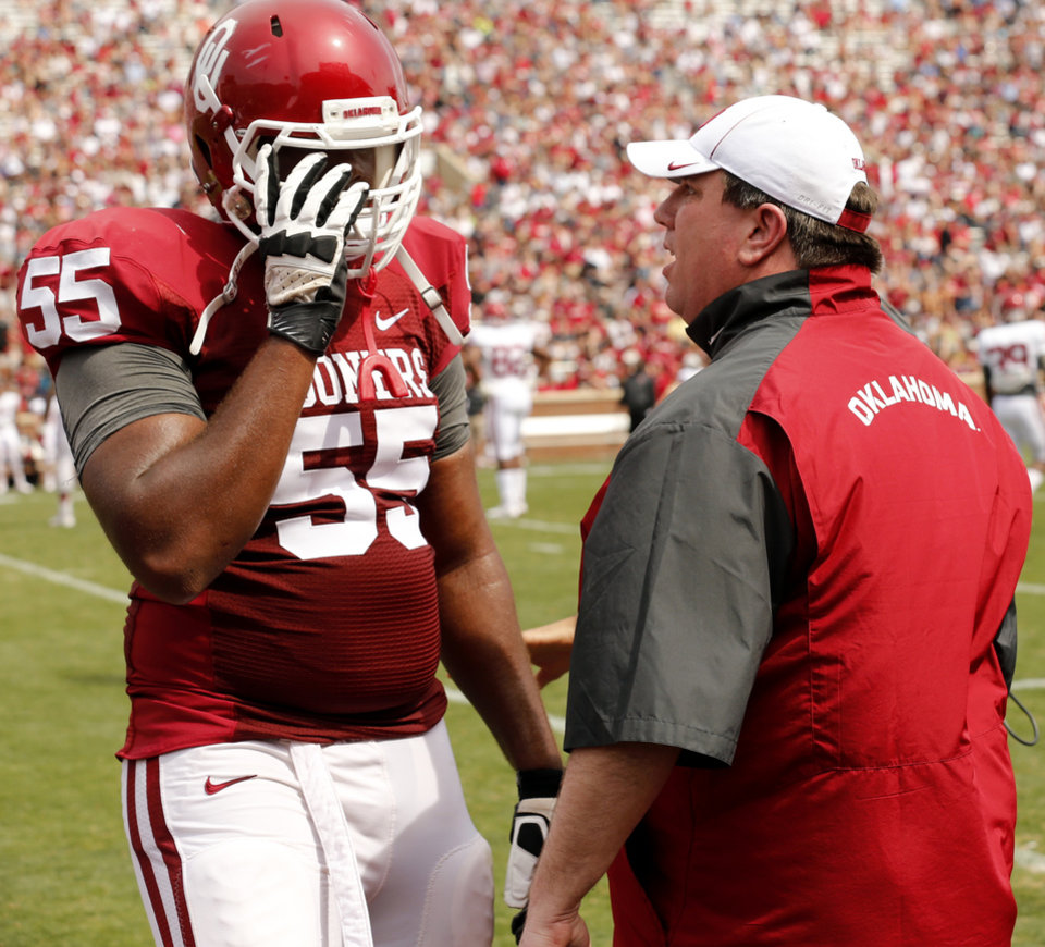Photo - Bill Bedenbaugh talks with Josiah St John during the Spring College Football Game of the University of Oklahoma Sooners (OU) at Gaylord Family-Oklahoma Memorial Stadium in Norman, Okla., on Saturday, April 12, 2014.  Photo by Steve Sisney, The Oklahoman