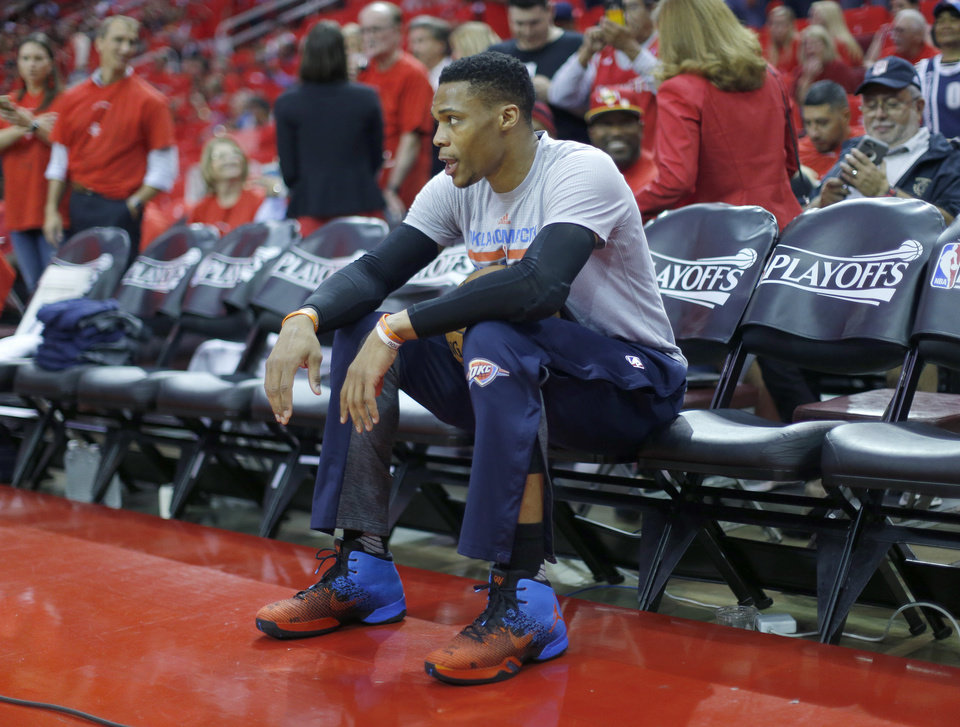 Photo - Oklahoma City's Russell Westbrook (0) sits on the bench before Game 5 in the first round of the NBA playoffs between the Oklahoma City Thunder and the Houston Rockets in Houston, Texas,  Tuesday, April 25, 2017.  Houston won 105-99. Photo by Sarah Phipps, The Oklahoman