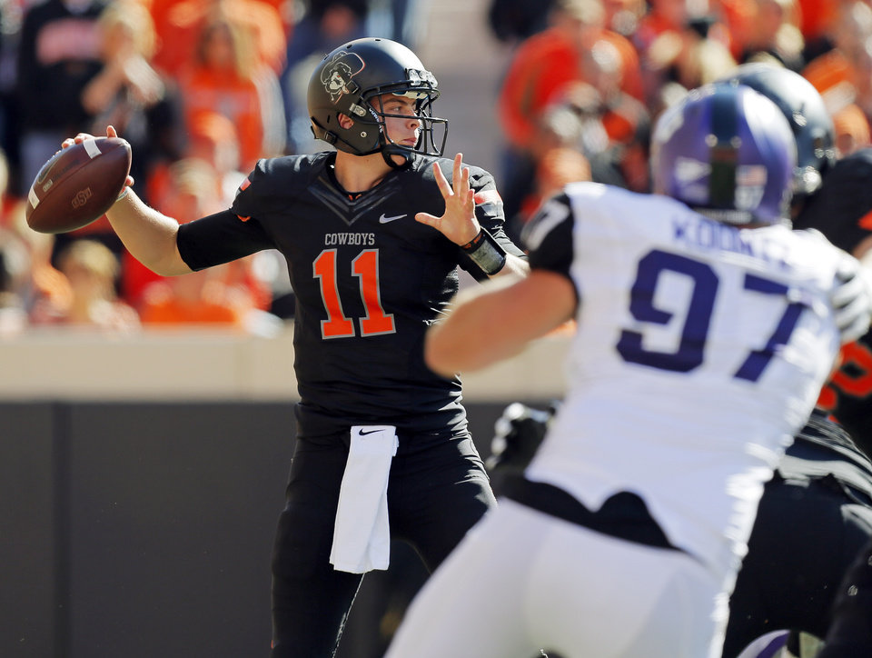 Photo - Oklahoma State's Wes Lunt (11) passes during a college football game between Oklahoma State University (OSU) and Texas Christian University (TCU) at Boone Pickens Stadium in Stillwater, Okla., Saturday, Oct. 27, 2012. Photo by Nate Billings, The Oklahoman