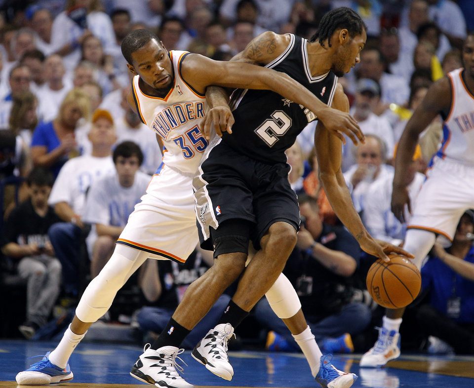Photo - Oklahoma City's Kevin Durant (35) defends against Kawhi Leonard (2) during Game 5 of the Western Conference Finals in the NBA playoffs between the Oklahoma City Thunder and the San Antonio Spurs at the AT&T Center in San Antonio, Thursday, May 29, 2014. Photo by Sarah Phipps, The Oklahoman