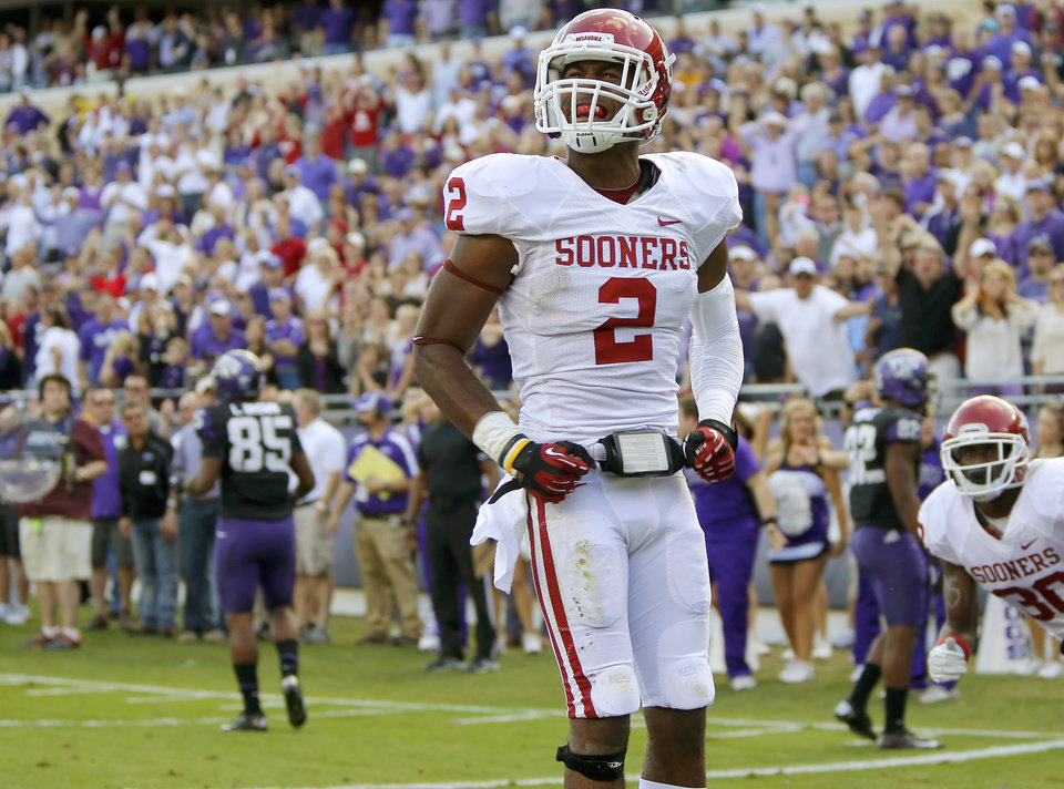 Photo - Oklahoma's Julian Wilson (2) celebrates after a failed scoring attempt by TCU in final seconds of the college football game between the University of Oklahoma Sooners (OU) and the Texas Christian University Horned Frogs (TCU) at Amon G. Carter Stadium in Fort Worth, Texas, Saturday, Dec. 1, 2012. Oklahoma won 24-17. Photo by Bryan Terry, The Oklahoman