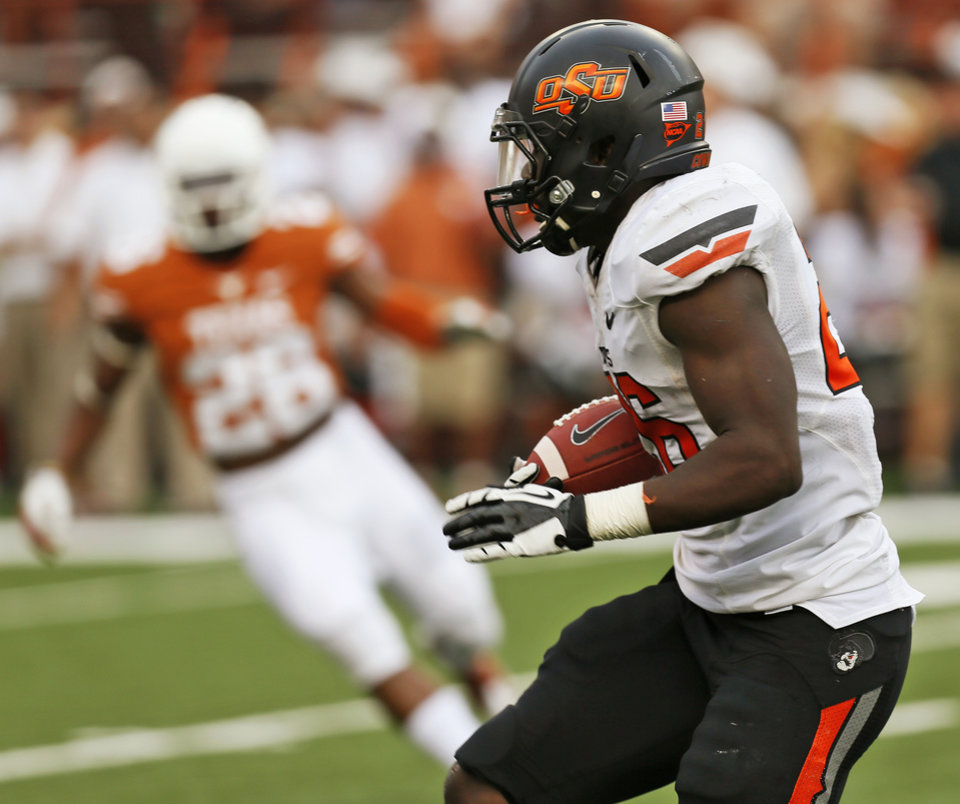 Oklahoma State\'s Desmond Roland (26) returns a kickoff in the second quarter during a college football game between the Oklahoma State University Cowboys (OSU) and the University of Texas Longhorns (UT) at Darrell K Royal - Texas Memorial Stadium in Austin, Texas, Saturday, Nov. 16, 2013. Photo by Nate Billings, The Oklahoman