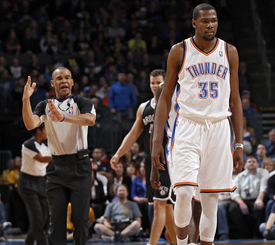 Photo - Kevin Durant (35) gets called for a technical before being thrown out of the game during the NBA basketball game between the Oklahoma City Thunder and the Brooklyn Nets at the Chesapeake Energy Arena on Wednesday, Jan. 2, 2013, in Oklahoma City, Okla. Photo by Chris Landsberger, The Oklahoman
