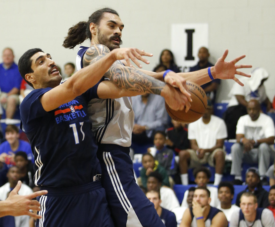 Photo - Oklahoma CIty's Steven Adams, right, and Enes Kanter fight for a rebound during the Thunder's annual Blue and White Scrimmage at John Marshall Mid-High School in Oklahoma City, Tuesday, Sept. 27, 2016. Photo by Bryan Terry, The Oklahoman