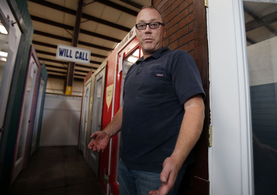 Photo - Michael Delaney said he's concerned a new state law intended to improve sales tax collections could result in the closing of some businesses. Photo by Steve Sisney, The Oklahoman