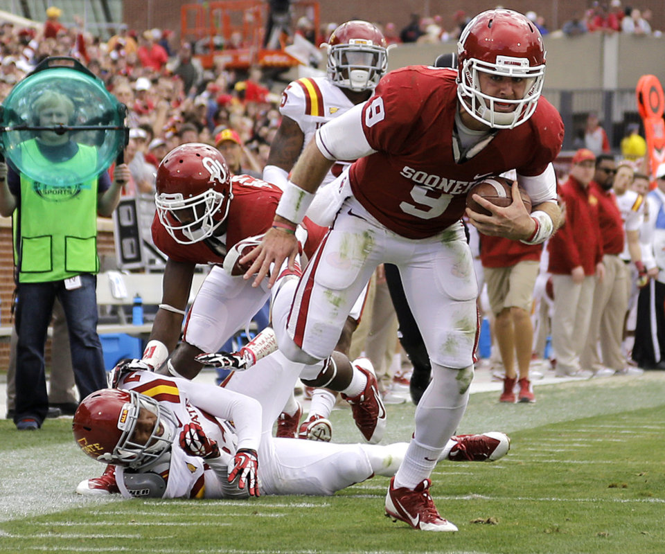 Photo - Oklahoma's Trevor Knight (9) runs in for a touchdown during the college football game between the University of Oklahoma Sooners (OU) and the Iowa State University Cyclones (ISU) at Gaylord Family-Oklahoma Memorial Stadium in Norman, Okla. on Saturday, Nov. 16, 2013. Photo by Chris Landsberger, The Oklahoman