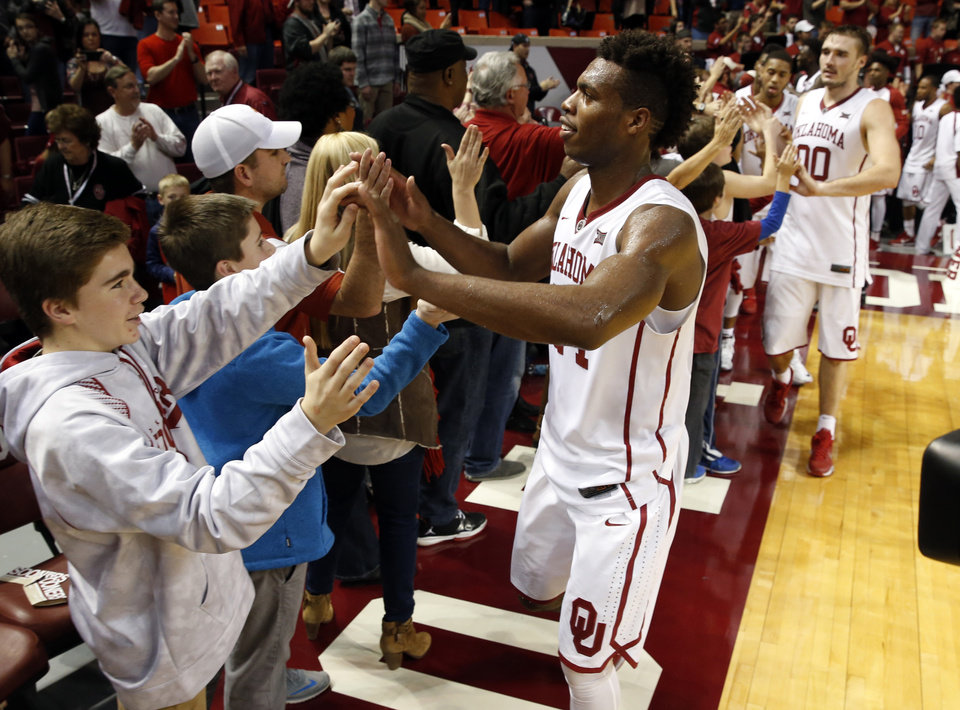 Photo -  Oklahoma's Buddy Hield (24), shown here shaking hands with fans following a Sooner home win, have had a lot to celebrate this season. The Sooners take a No. 2 ranking to Stillwater on Wednesday for the Bedlam game against Oklahoma State. [Photo by Steve Sisney, The Oklahoman]