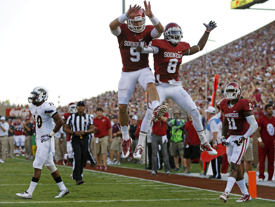 Oklahoma's Trevor Knight (9), Jalen Saunders (8), and Lacoltan Bester (11) celebrate a touchdown beside Louisiana Monroe's Cordero Smith (10) during a college football game between the University of Oklahoma Sooners (OU) and the University of Louisiana Monroe Warhawks at Gaylord Family-Oklahoma Memorial Stadium in Norman, Okla., on Saturday, Aug. 31, 2013. Photo by Bryan Terry The Oklahoman