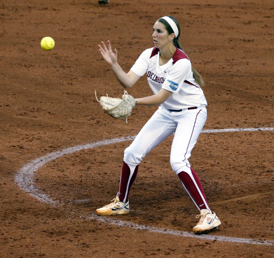 Photo - Oklahoma's Kelsey Stevens pitches and fields as she catches a ground ball from batter Taylor Koenig as the University of Oklahoma Sooner (OU) softball team plays Tennessee in the first game of the NCAA super regional at Marita Hynes Field on May 23, 2014 in Norman, Okla. Photo by Steve Sisney, The Oklahoman