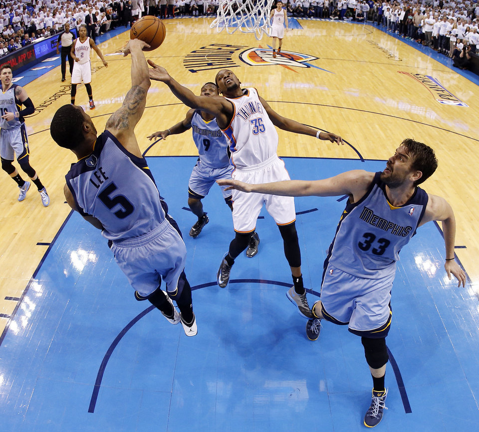 Photo -                    Oklahoma City's Kevin Durant has his shot blocked by Memphis' Courtney Lee, left, as Marc Gasol, right, and Tony Allen give chase during Game 5 on Tuesday at Chesapeake Energy Arena. Durant and the Thunder are now on the brink of elimination after a 100-99 overtime loss.                     Photo by Nate Billings, The Oklahoman