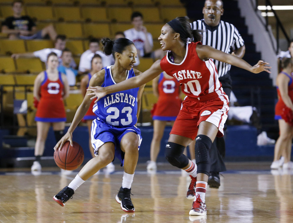 Booker T. Washington's No.23 Kaylan Mayberry on the east team tries to get around Edmond Santa Fe's No.10 Cameerah Graves on the west during the large All State Basketball game at the ORU Mabee Center in Tulsa, Okla., taken on July 31,2013. JAMES GIBBARD/Tulsa World