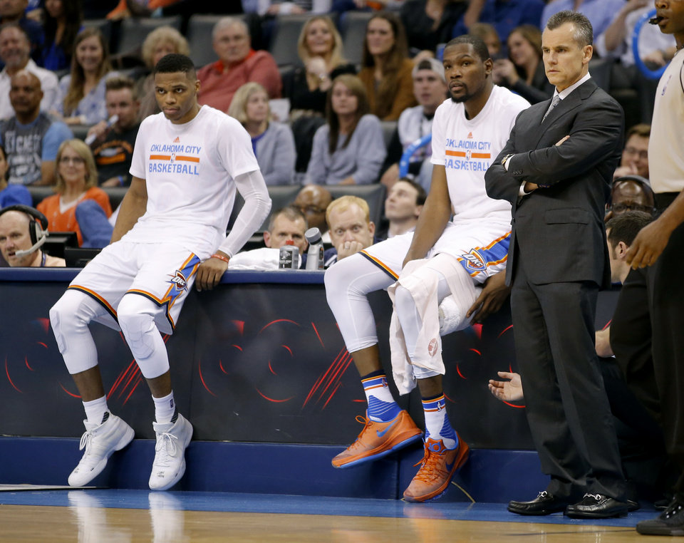 Photo - Oklahoma City's Russell Westbrook and Kevin Durant sit beside coach Billy Donovan during an NBA basketball game between the Oklahoma City Thunder and the Brooklyn Nets at Chesapeake Energy Arena on Wednesday, Nov. 25, 2015. Oklahoma City won 110-99. Photo by Bryan Terry, The Oklahoman