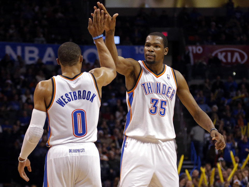 Oklahoma City\'s Russell Westbrook (0) and Oklahoma City\'s Kevin Durant (35) celebrate during the NBA game between the Oklahoma City Thunder and the Indiana Pacers at the Chesapeake Energy Arena, Sunday, Dec. 8, 2013. Photo by Sarah Phipps, The Oklahoman