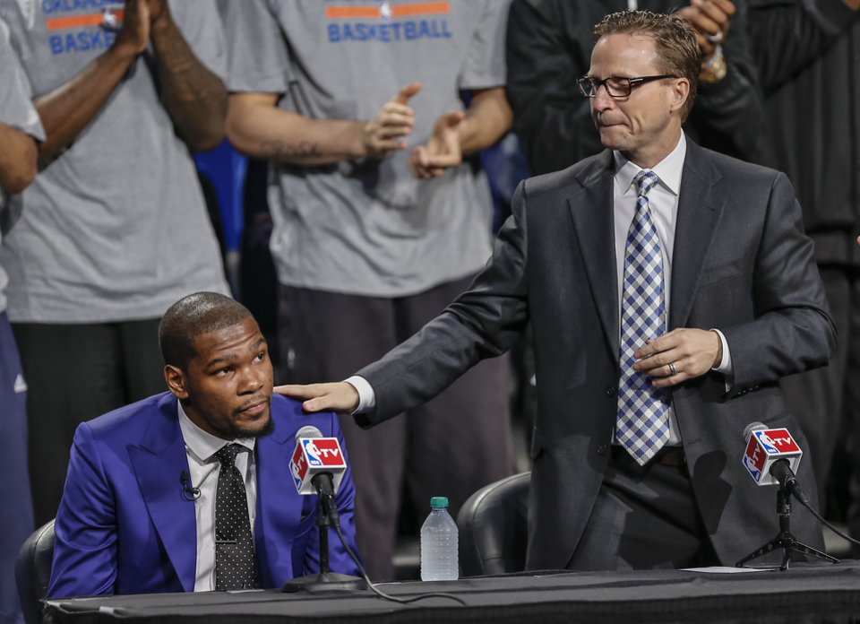Photo - Coach Scott Brooks pats Kevin Durant on the shoulder as Durant gets emotional during a news conference announcing Oklahoma City Thunder's Kevin Durant as the winner of the 2013-14 Kia NBA Basketball Most Value Player Award in Oklahoma City, Okla. on Tuesday, May 6, 2014. Photo by Chris Landsberger, The Oklahoman