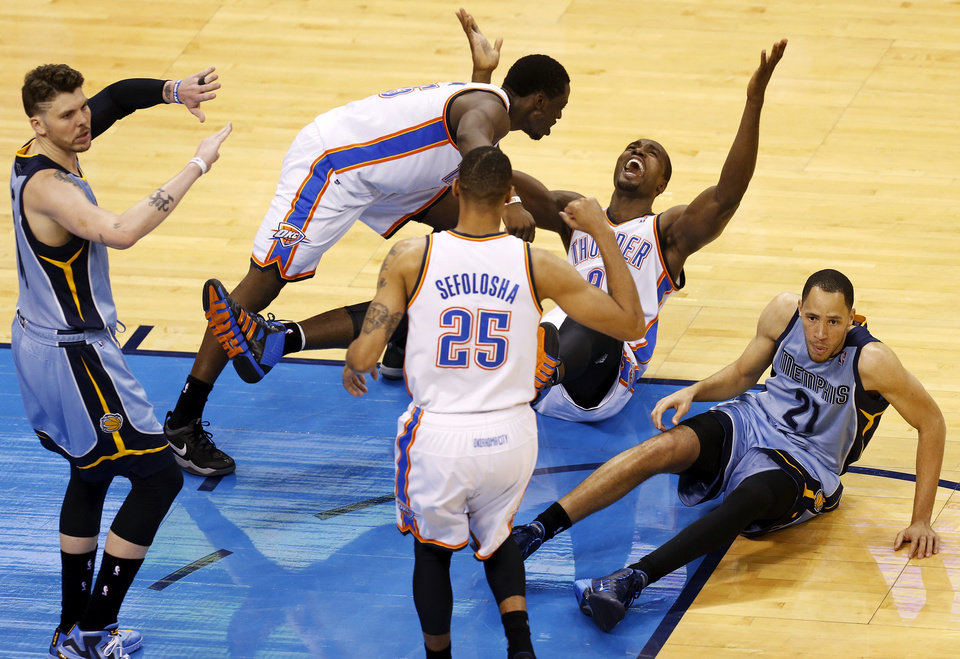 Photo - Memphis' Mike Miller (13) signals for no basket as Oklahoma City's Serge Ibaka (9), Reggie Jackson (15) and Thabo Sefolosha (25) celebrate a possible game-wining shot by Ibaka at the end of overtime near Memphis' Tayshaun Prince (21) during Game 5 in the first round of the NBA playoffs between the Oklahoma City Thunder and the Memphis Grizzlies at Chesapeake Energy Arena in Oklahoma City, Tuesday, April 29, 2014. Instant replay showed Ibaka's shot came after the buzzer. Memphis won 100-99 in overtime. Photo by Nate Billings, The Oklahoman