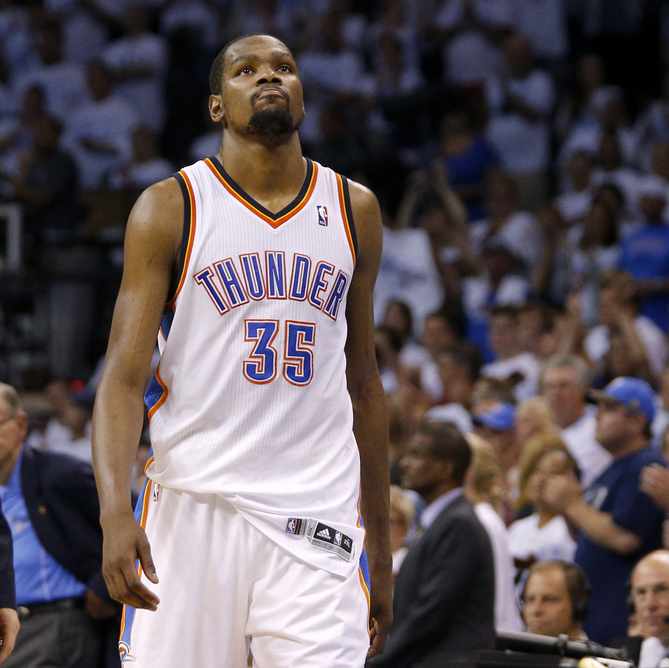 Oklahoma City\'s Kevin Durant (35) leaves the game late in Game 6 of the Western Conference Finals in the NBA playoffs between the Oklahoma City Thunder and the San Antonio Spurs at Chesapeake Energy Arena in Oklahoma City, Saturday, May 31, 2014. Oklahoma City lost 112-107. Photo by Bryan Terry, The Oklahoman
