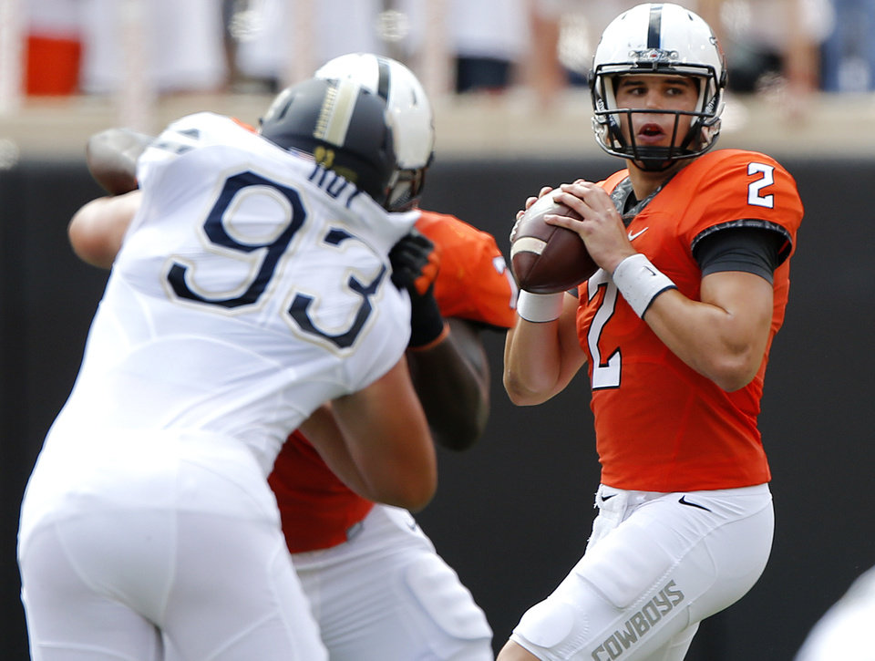 Photo - Oklahoma State's Mason Rudolph (2) look to pass the ball during a college football game between the Oklahoma State Cowboys (OSU) and the Pitt Panthers at Boone Pickens Stadium in Stillwater, Okla., Saturday, Sept. 17, 2016. Photo by Chris Landsberger, The Oklahoman