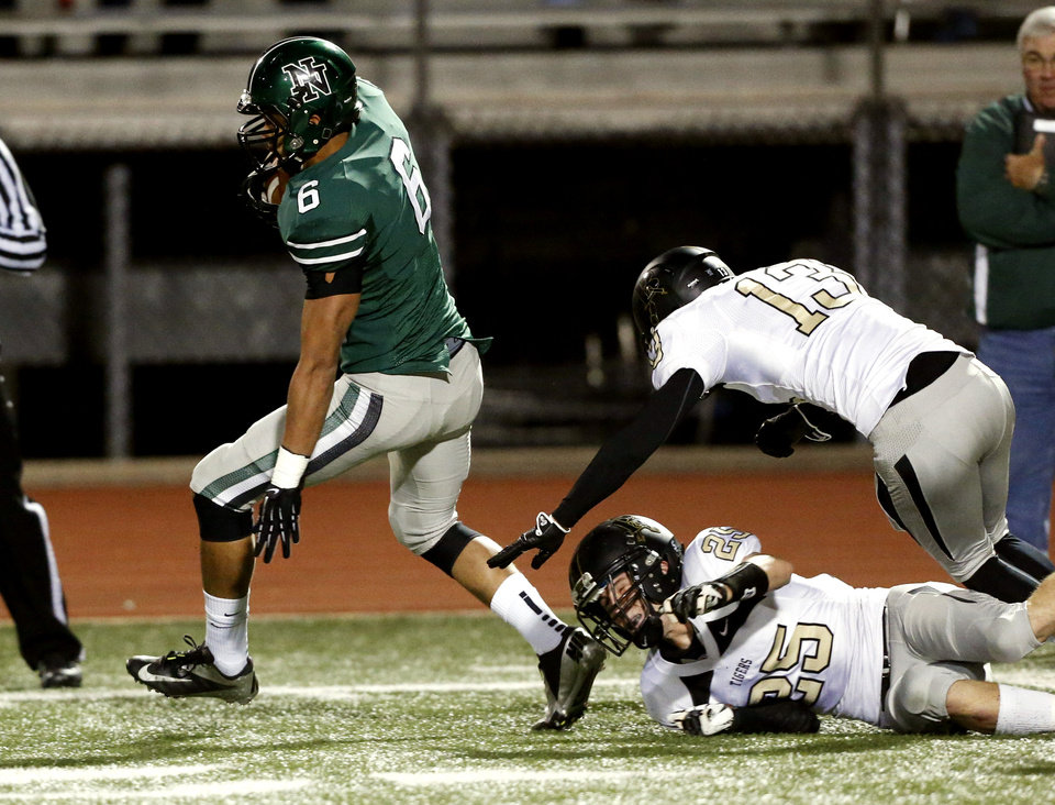 Photo - Norman North's Jordan Evans eludes two Broken Arrow players and then the rest of the team as he returns a punt for a touchdown in class 6A football on Friday, Nov. 16, 2012 in Norman, Okla.  Photo by Steve Sisney, The Oklahoman