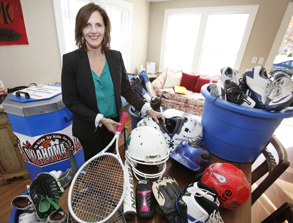 Stacy McDaniel has three active kids � and that means she has lots of athletic equipment that they�ve used. That prompted her to start Oklahoma Cleats for Kids.  Photo By David McDaniel, The Oklahoman