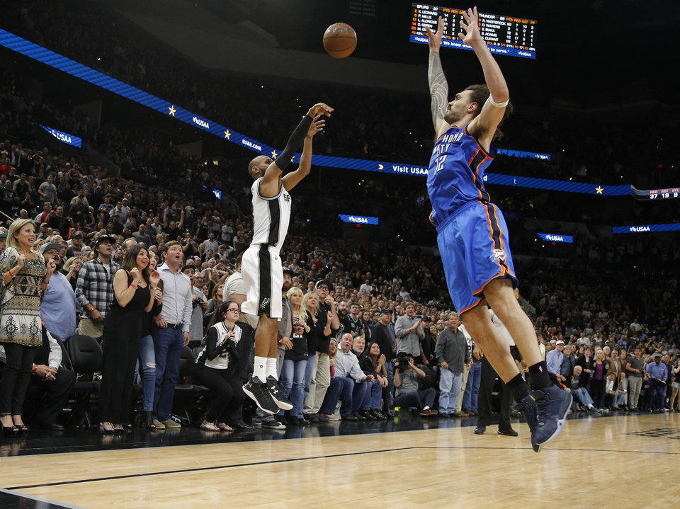 Photo - San Antonio's Patty Mills (8) shoots over Oklahoma City's Steven Adams (12) in the last seconds of Game 2 in the second-round series between the Oklahoma City Thunder and the San Antonio Spurs in the NBA playoffs at the AT&T Center in San Antonio, Monday, May 2, 2016. Oklahoma City won 98-97. Photo by Bryan Terry, The Oklahoman