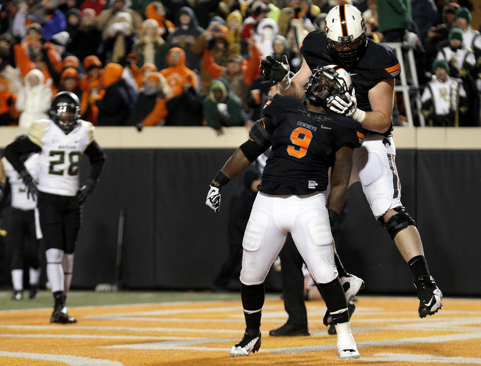Oklahoma State's Kye Staley (9) and Parker Graham (71) celebrate a Staley touchdown in front of Baylor's Orion Stewart (28)  the third quarter during a college football game between the Oklahoma State University Cowboys (OSU) and the Baylor University Bears (BU) at Boone Pickens Stadium in Stillwater, Okla., Saturday, Nov. 23, 2013. Photo by Sarah Phipps, The Oklahoman