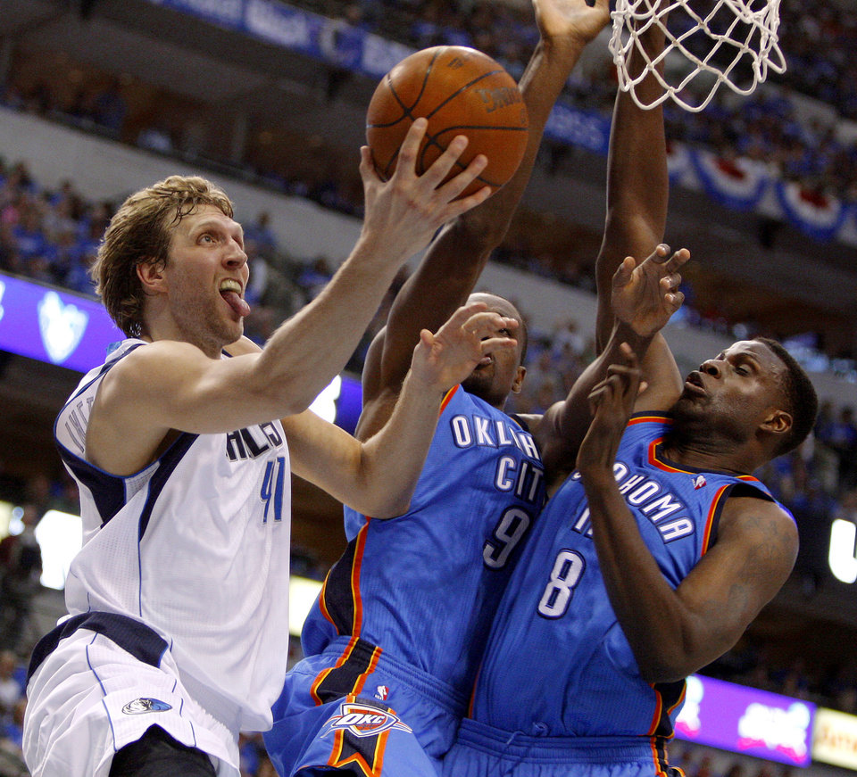 Photo - Dallas' Dirk Nowitzki (41) goes to the basket beside Oklahoma City's Serge Ibaka (9) and Nazr Mohammed (8) during Game 4 of the first round in the NBA playoffs between the Oklahoma City Thunder and the Dallas Mavericks at American Airlines Center in Dallas, Saturday, May 5, 2012. Oklahoma City won 103-97.  Photo by Bryan Terry, The Oklahoman