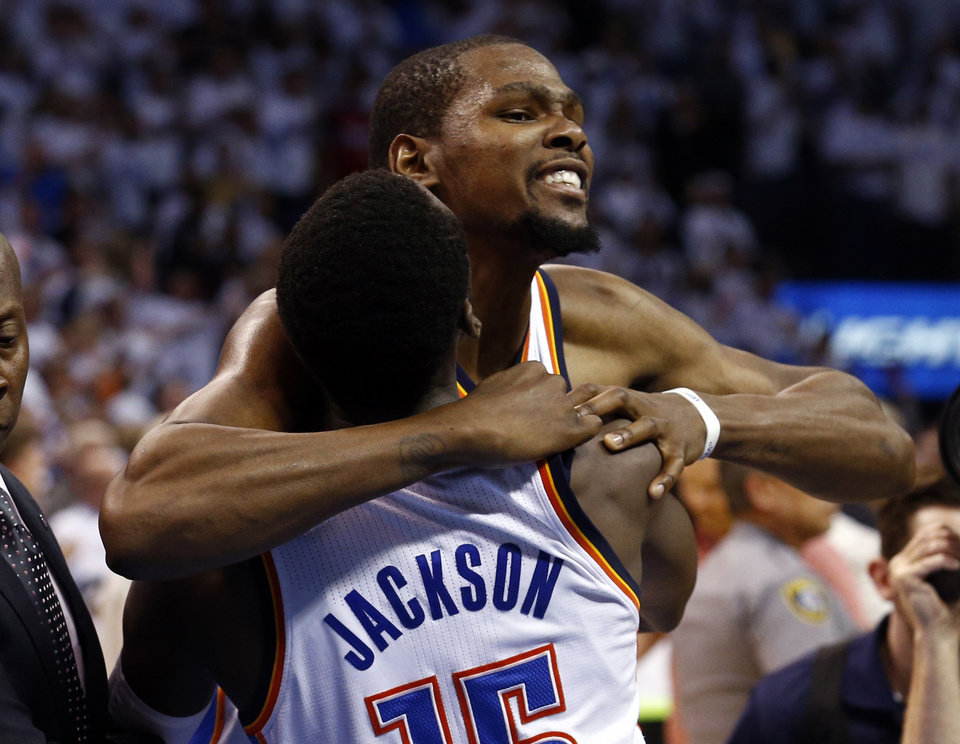 Photo - Oklahoma City's Kevin Durant (35) hugs Reggie Jackson (15) follow the Thunder's win during Game 5 of the Western Conference semifinals in the NBA playoffs between the Oklahoma City Thunder and the Los Angeles Clippers at Chesapeake Energy Arena in Oklahoma City, Tuesday, May 13, 2014. Photo by Sarah Phipps, The Oklahoman